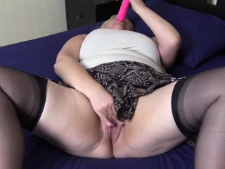 Horny Stepmom in stockings takes time out to poke her wet Pussy with thick Dildo