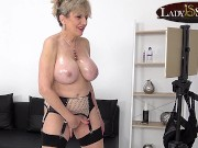 Naughty British mature Lady Sonia lubes her tits then finger fucks her tight cunt