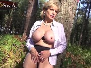 Busty blonde MILF Lady Sonia shows off her big tits in public then plays with her clit outdoors